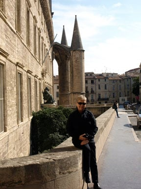 I am sitting with my new hair cut in front of the steeple.  This is the oldest still practicing University of Medicine in Europe.  It is in Montpellier.
