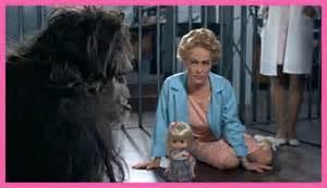 Joan Crawford plays dolls with Trog