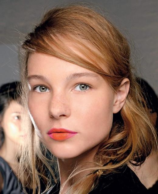 A model wearing Creamy Matte Lip Color in Jenna.