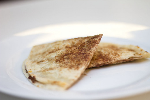 A tortilla grilled with cinnamon sugar and stuffed with chocolate and caramel.