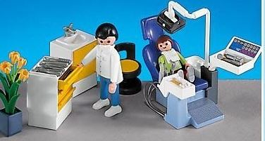 A toy dental set which features a child preparing for a dental check up.