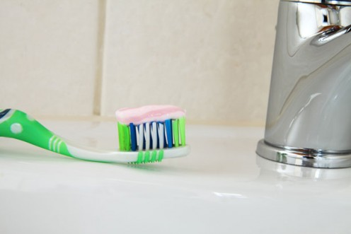 A picture of a toothbrush topped with toothpaste represents good brushing methods.