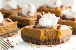 pumpkin pie squares with dollop of whipped cream and nuts