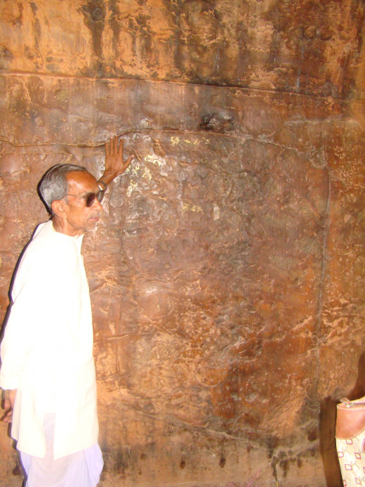 Guide Showing Us The Maha Kashyapa Inscription At Son Bhandar Caves