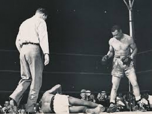 Joe Louis survived a third round knockdown to come back and knockout Jersey Joe Walcott in 11 rounds in their rematch.