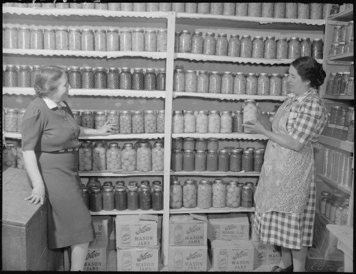 New Mexico. Mrs. Fidel Romero proudly exhibits her canned food.