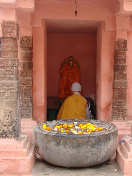 Monk Prays At A Shrine Outside Mahabodhi Temple
