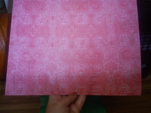 Sketch out the letters happy easter on scrapbooking paper.