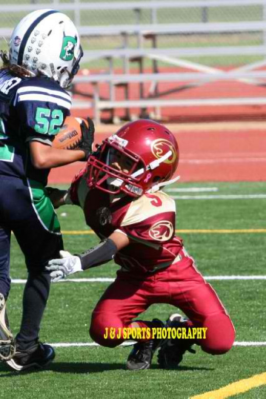 My son tackling at 8 years old.