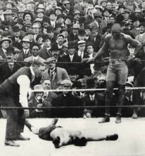 Jack Johnson defended his heavyweight crown by knocking out Stanley Ketchel. Johnson knocked Ketchel's front teeth out with the knockout blow.