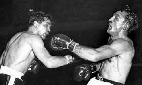 Carmen Basilio fought Tony DeMarco twice and he won both bouts by 12th round knockout.