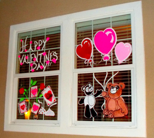 Celebrate Valentine's Day with a unique collage of holiday images painted on the window glass of the home or office.