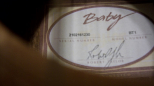 This photo shows the model number of the Baby Taylor, and the serial number.