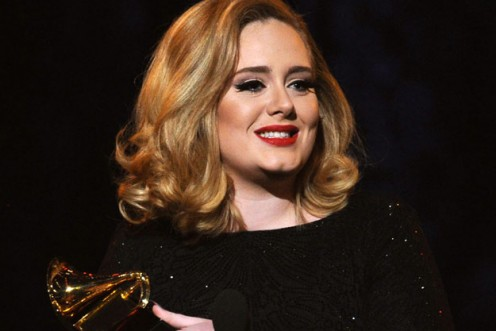 Adele receiving a Grammy Award for Rolling in the Deep