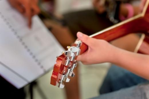 """""""Teacher Teaches Guitar"""""""