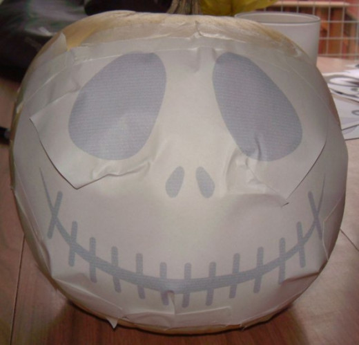 This is the Jack pattern, taped to a white pumpkin and all ready to start.