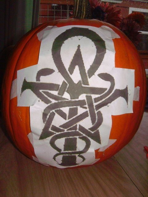 The design taped to the pumpkin to start.