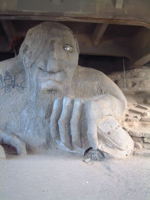 Found under the bridge in the neighborhood of Fremont (Seattle's self-proclaimed center of the universe) is the Fremont Troll. This one-eyed monster has gotten his hands on a VW and is slowly crushing it. If you sneak up very carefully, you can somet