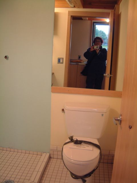This shot of me in the bathroom mirror shows a toilet, and the shower corner.