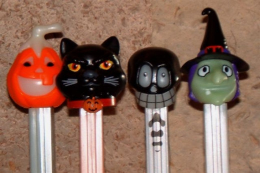 Shown here is the newest Jack O' Lantern variation, along with the lovely Black Cat, a very goofy-looking one called the Mummy and another rendition of the Witch. The Mummy really looks more like a skull than what most people would call a mummy. And