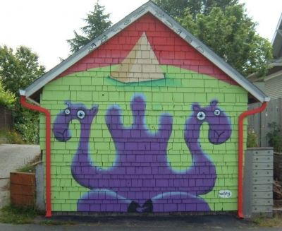 "A ""henry"" mural on a neighborhood garage"