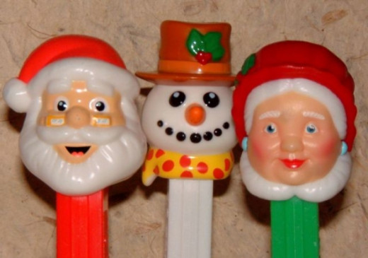 After many years as a PEZ, Santa has finally been joined by Mrs. Claus!  And they have an updated snowman who has round teeth instead of square ones, a bright hat and a festive holiday scarf.