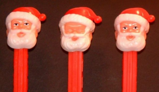 """On the left you can see the """"classic"""" Santa. He existed like this for many years and was only reissued more recently. In the middle is one of the """"no eyes"""" Santas, which came to me the good ol' fashioned way, by just finding him on a shelf. Those are"""