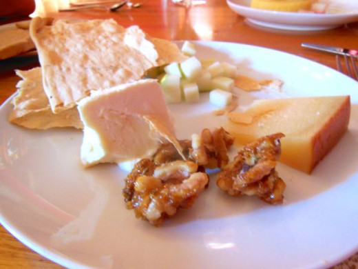 Nuts, sometimes spiced or glazed, are popular sides to go with a cheese assortment.
