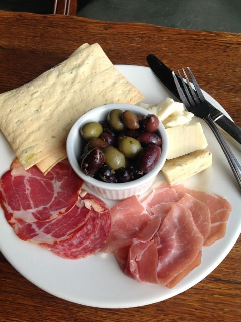 The charcuterie plate can even be a meal, with crackers, veggies/pickles and exotic meats accompanying the cheeses.