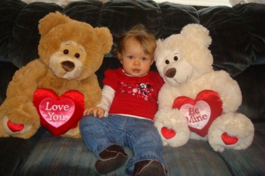 Little girl with big teddy bears