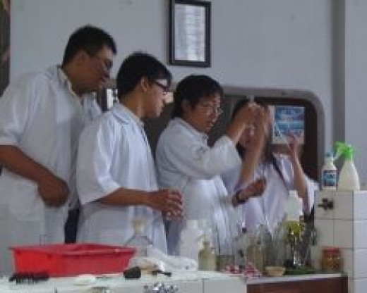The photo of a chemistry practical class is by Dennis Kwaria, and is in the public domain.