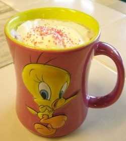 A Tweety mug and sprinkles make cocoa more delicious