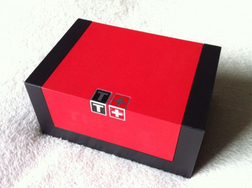 Under the presentation sleeve, there is a smart red and black box