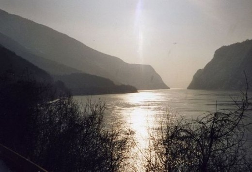 The photo shows a view of the Danube Rivier, near the Iron Gate Dam. Original photo taken by Frans van Nes, and released into the public domain.