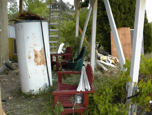 This is the pile of discarded materials that will have to be gotten rid of when all the work is done. I'm sure more will be added by then. I'm hoping they will also take away the old water tank.