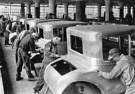 Typical early automobile assembly line