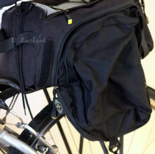 View of the panniers, which expand out to a good size.  There is an elastic hook that works well and holds the panniers down very well.
