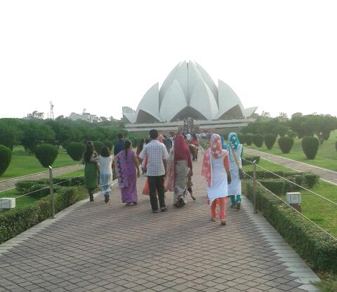 Lotus Temple is in the center of green garden