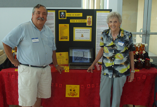 "Jim Arnold and Linda Fessel sell their honey at ""Honey Bee Appreciation Day"" in Orlando Florida."