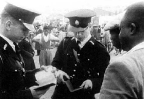 Policemen examine passes