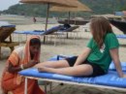 Siobhan getting a henna tattoo on the beach