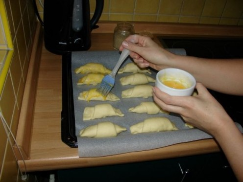Put just a little milk into the egg yolk and cover your crescent rolls with it. That way you can sprinkle them with the sesame seeds if you like plus it'll give them a beautiful color when they're done.