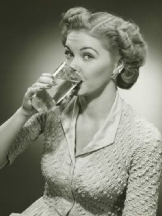 Woman Drinking Water From Tall Glass