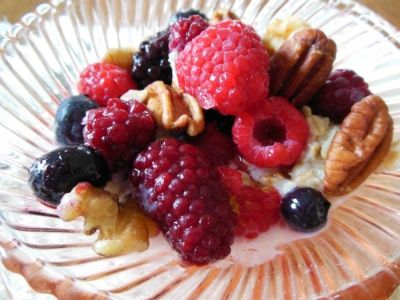 Closeup of Mixed Berries and Nuts Over Oatmeal