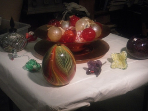 I bought one of these hand blown glass flowers from the Indigo Glass Studio. I love glass and this was affordable.