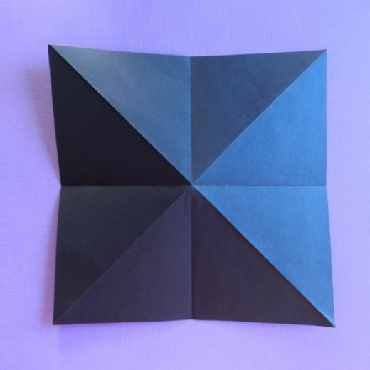Turn paper over and fold twice side to side.