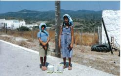 Young village girls picking figs.