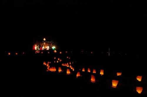 Luminaria light the way.