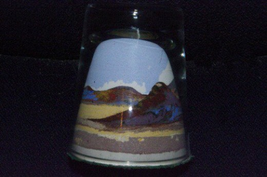Sand painting in glass made by a Native American.
