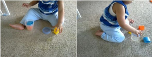 my curious son playing with Avent VIA cups and lids